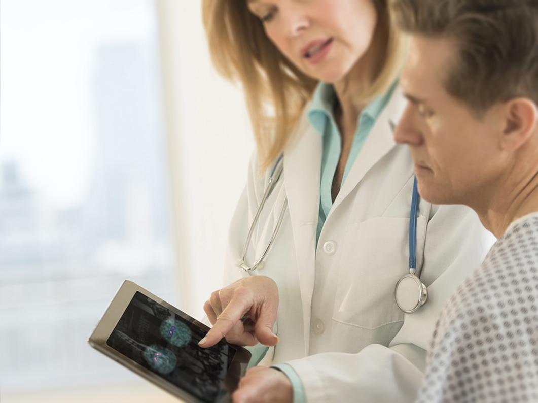 clinician with tablet device